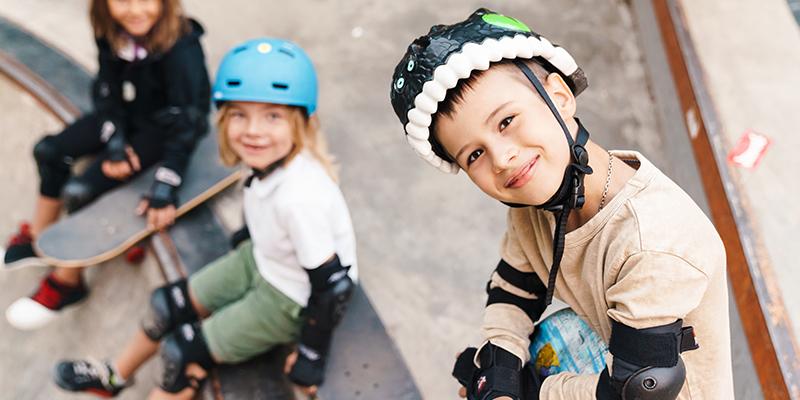 Kids in helmets at the skate park